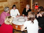 photo of people sitting round a table